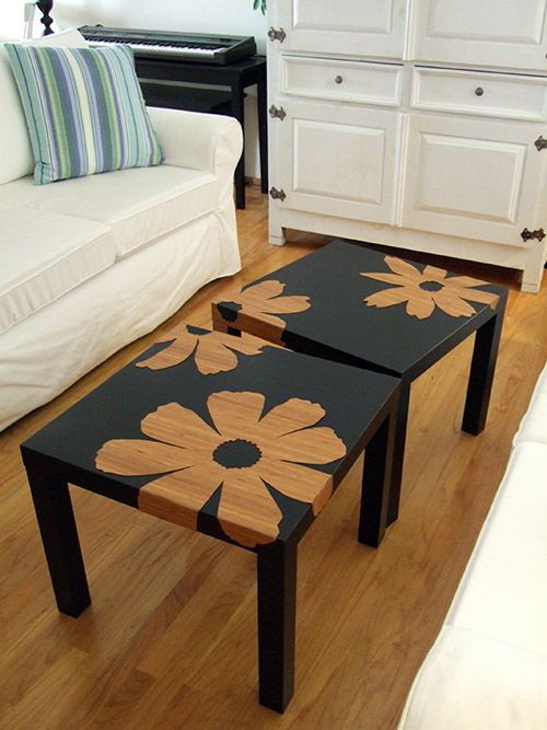 black wooden coffee table with flower pattern, wooden floor, white sofa, white wooden cabinet