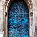 Blue Doors With Grapes Patterned Wrought Iron Details On The Surface