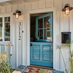 Blue Painted Door With Half Open With Glass Window On Top Part, White Wall, Sconce, Colorful Mat
