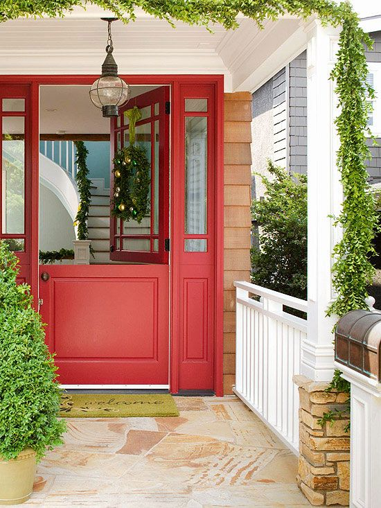 bold red door with clear glass on openable half top, brown floor, brown plank wall, white ceiling, pendant