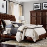 Brown Bedroom Furniture Brown Leathered Tufted Headboard Brown Leathered Bed Brown Cupboard Area Rug White Table Lamp Bedside Table Windows Curtains