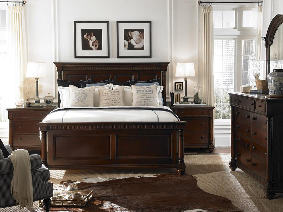 brown bedroom furniture frames table lamp brown nightstands wooden bed wooden headboard wooden dresser mirror cowhide rug gray armchair windows