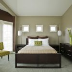 Brown Bedroom Furniture Tan Walls Windows Yellow Chair Brown Bed Headboard Floor Lamp Nightstands Brown Dresser Rattan Side Table Bedding Pillows