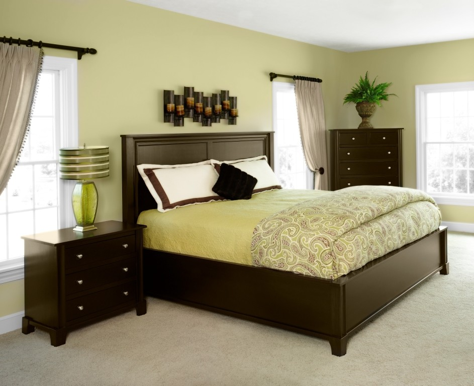 brown bedroom furniture wall art white windows beige curtains black rod yellow bedding brown bed headboard high dresser nightstand green glass table lamp
