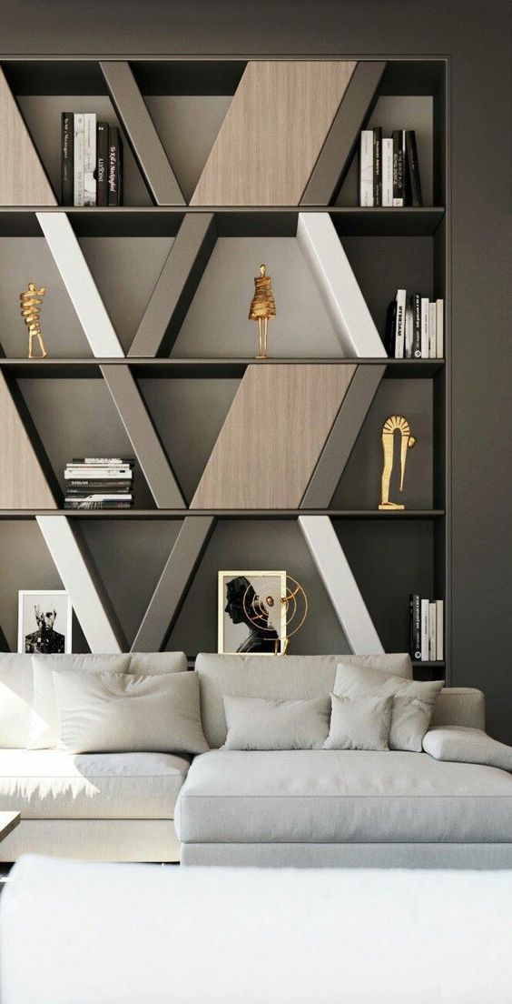 built in shelves with geometrical boxes, dark grey wall, white sofa