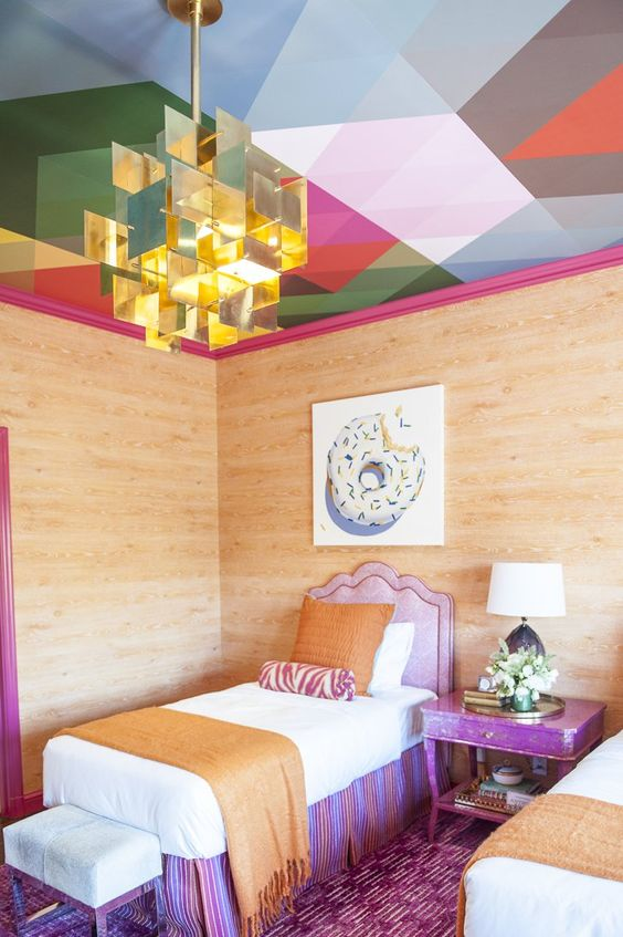 colorful geometric blocks, pink frame, glass pendant, wooden wall, purple rug, purple bed platform