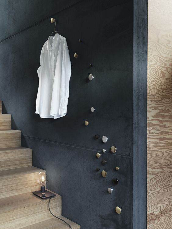 dark blue wall on the stairs, wooden stairs, metallic pins
