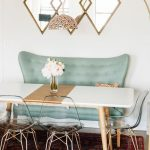 Dining Nook, Green Tufted Sofa, Acrylic Chairs, Red Rug, Wooden Floor, White Wall, Mirror, Floor Lamp