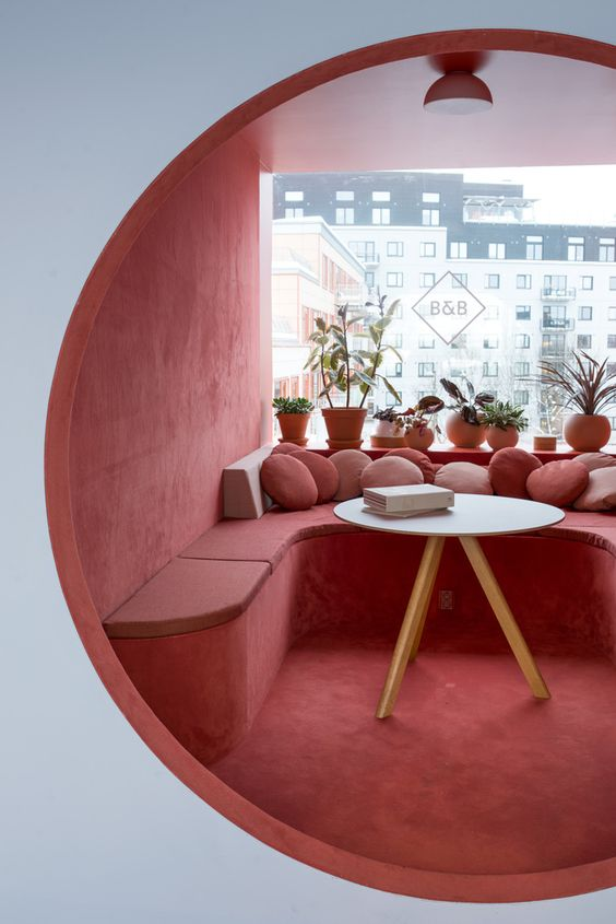 dining nook, white wall, red velvet floor, wall, bench, white round table, red ceiling