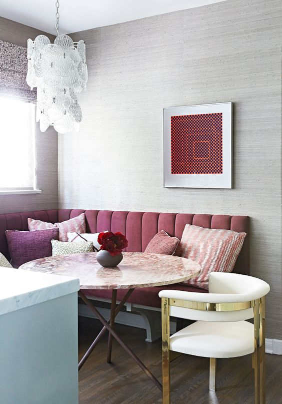 dining nook, wooden floor, white chair, pink corner bench, wallpaper, chandelier