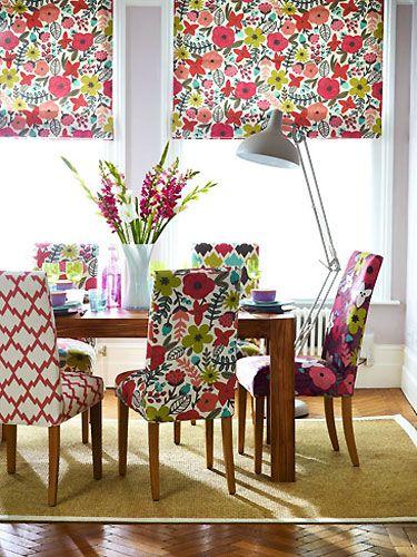 dining room, herringbone wooden floor, brown rug, flower patterned chair, wooden table, flowery shade