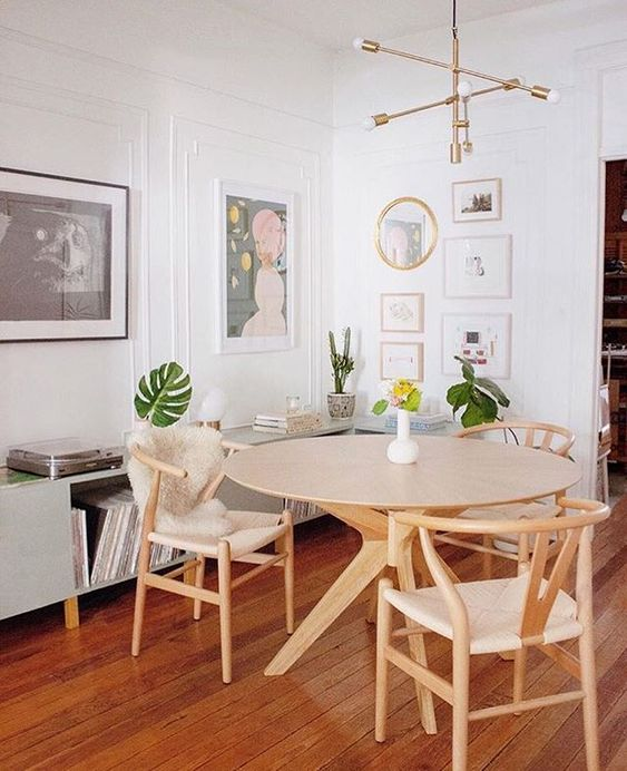dining room, wooden floor, round wooden table, wooden chair with rattan seating, white wall, modern pendant