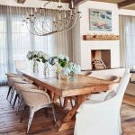 Dining Room, Wooden Floor, Wooden Table, Metal Table With Rattan Back, Chandelier, White Chair, White Brick Fireplace