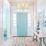 Entrance, Wooden Floor, Colorful Rug, White Wall, Blue Door, Wooden Bench, Mirror, Chandelier