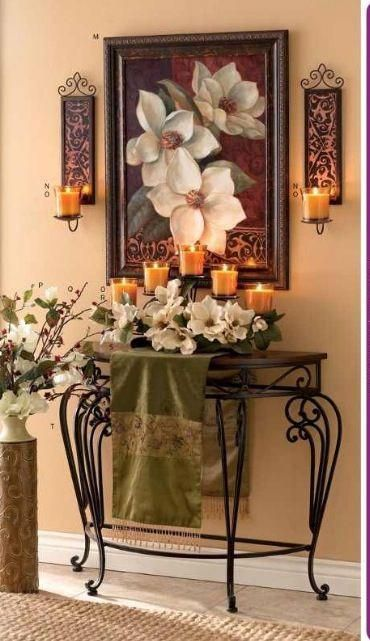 entrance, wooden floor, rattan rug, beige wall, half round table with blackmetal legs, candles