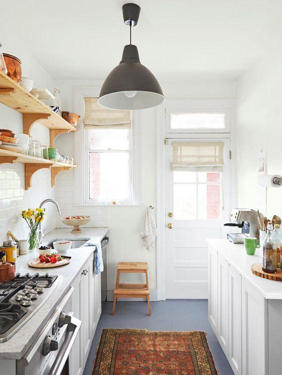 galley kitchen, grey floor, white cabinet, white wall, floating shelves, black pendant