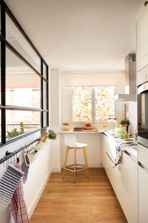 galley kitchen, wooden floor, rails on the side, white bottom cabinet, window, white modern stool