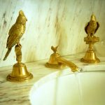 Golden Faucet With Small Birds, Golden Birds Accessories With The Faucet, Marble Sink And Wall