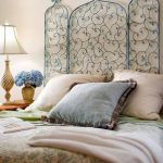 Green Curvy Detailed Headboard, Brown Pillows, Wooden Side Table, White Table Lamp