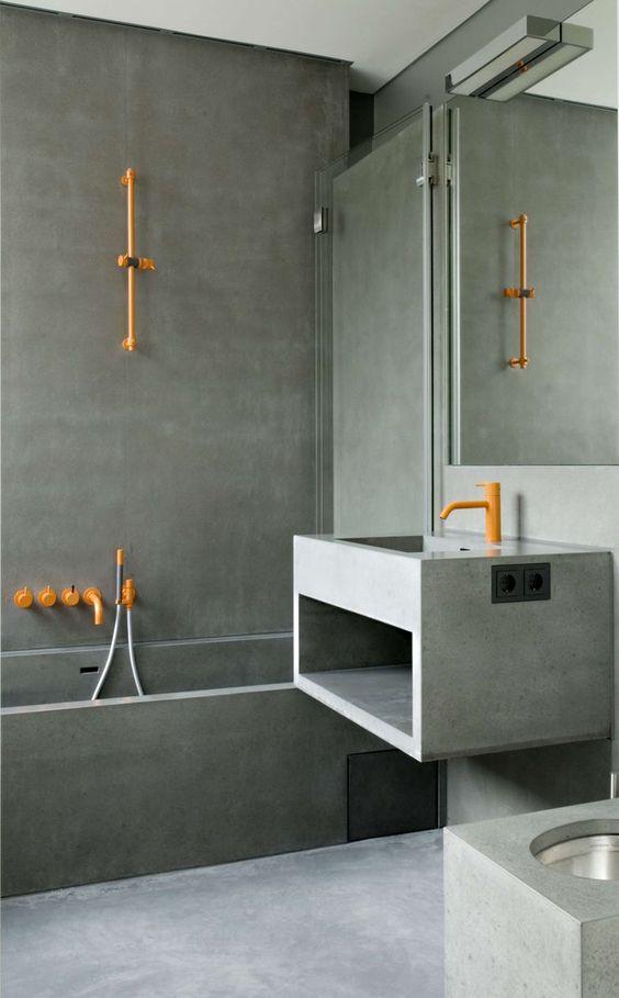 grey seamless bathroom, built in tub, floaitng vanity sink, orang faucet