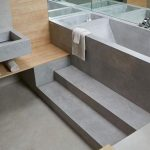Grey Seamless Bathroom, Built In Tub, Vanity Sink, Wooden Accent Shelves