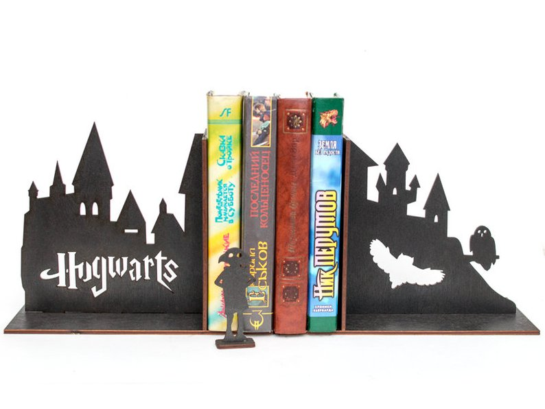 hogwarts book ends with castle, owl and house elves