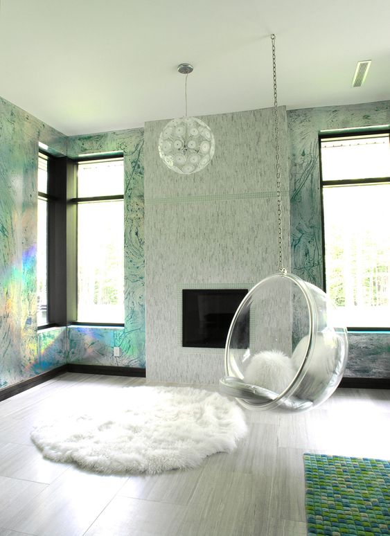 hologram wall, glass window, wooden floor, fireplace, white rug, green rug, white pendant, clear glass round swing