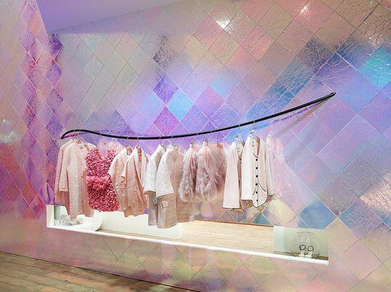 hologram wall tiles, wooden floor, black lines hanger for clothes