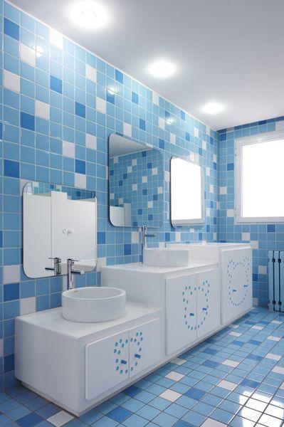 kids toilet, blue white floor and wall tiles, white vanity wth three height, mirror, white round sink