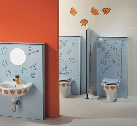 kids toilet, white floor, blue cabinet behind white toilet, blue cover, blue cabinet behind white sink