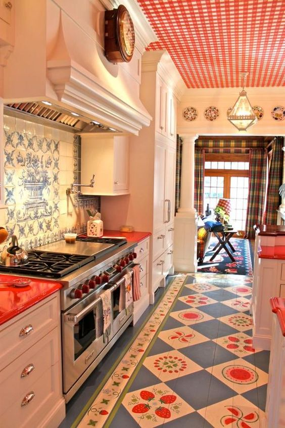 kitchen, blue patterned floor tiles, white cabinet, patterned backsplash, red white plaid statement ceiling, white wall