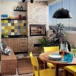 Kitchen, Wooden Floor, Stone Floor, Rattan Bench, Wooden Round Table, Yellow Chairs, Wooden Bottom Cabinet, White Wall, Yellow Patterned Backsplash, Black Pendant