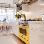 Kitchen, Wooden Floor, White Bottom Cabinet, Yellow Stove, White Backsplash, White Upper Cabinet, Rug