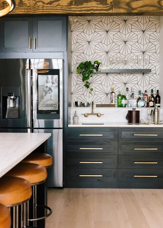 kitchen, wooden floor, white geometrical wall tiles, black bottom cabinet, white top, white island top, brown leather stools