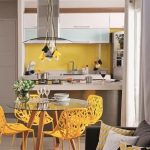 Kitchen, Yellow Detailed Chair, Glass Top Round Table, Silver Kitchen, Yellow Backsplash, Yellow, White, Black Pendants, Grey Sofa