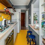 Kitchen, Yellow Floor, Yellow Square Tiny Tiles Backsplash, White Bottom Cabinet, Wooden Floating Shelves, Grey Island With White Top, Blue Stool, White Shelves