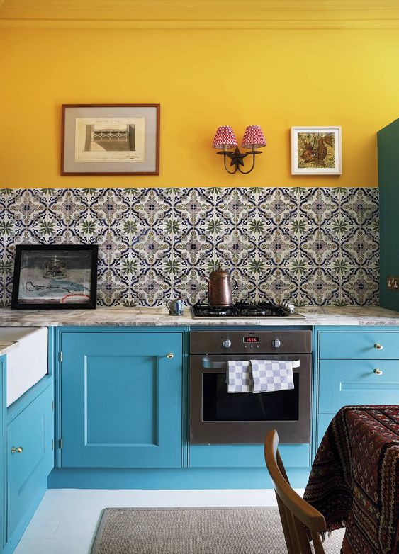 kitchen, yellow wall, patterned backsplash, green bottom cabinet, white floor, grey marble top