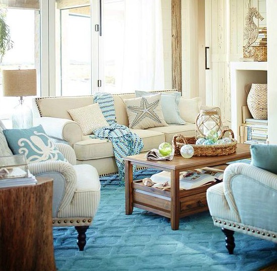 living room, blue rug, beige sofa, striped chairs, wooden coffee table, wooden slab side table, white wall, glass window
