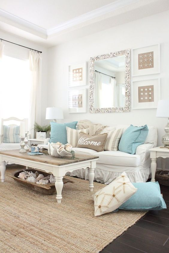 living room, dark brown floor tiles, rattan rug, white wall, white curtain, white sofa, white coffee table, blue pillows, white table lamp