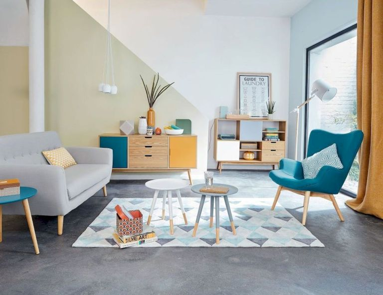 living room, grey floor, white wall, grey sofa, green sofa, patterned rug, yellow green cabinet, wooden shelves nesting table
