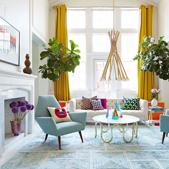 living room, soft blue rug, white wall, white sofa, blue chair, white round coffee table, yellow curtain, pendant, white fireplace