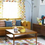 Living Room, White Floor, Colorful Rug, Yellow Sofa, Light Blue Wall, Wooden Cabinet, Colorful Curtain, Wooden Coffee Table