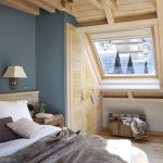 Master Bedroom, Wooden Floor And Ceiling, Wooden Cabinet, Sloping Clear Glass Window, Blue Wall, White Sconce, White Bedding