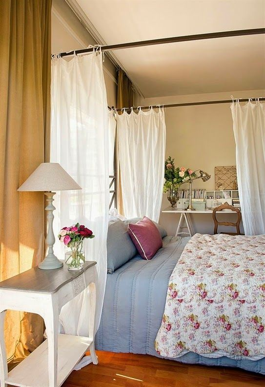 master bedroom, wooden floor, beige wall, white bed curtain, blue bed, white wooden side table, white wooden study table