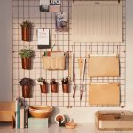Metal Wall Grid, Papers Clipped, Copper Glass Clipped, Small Rattan Basket Clipped, White Bottom Cabinet, White Wall