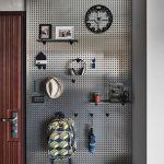 Metallic Pegboard, Shelves, Hooks, Grey Floor, Wooden Door