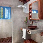 Minimalist Bathroom, Grey Surface On Floor, Wall, Partition, Floating Vanity, Brown Earthen Ware Sink, Floating Cabinet With Mirror, Wooden Floor, Blue Framed Window