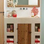 Minimalist Bathroom, White Plaster Vanity, Built In Shelves, Wooden Door, Wooden Framed Mirror, White Wall