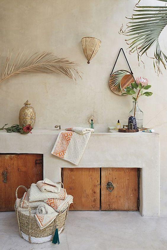 minimalist kitchen, white plastered wall and cabinet, wooden doors, grey floor