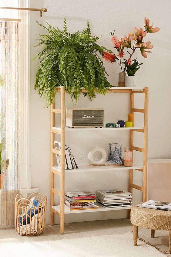 minimalist wooden shelves, off white wall, wooden floor, brown rug, bamboo stool, rattan basket